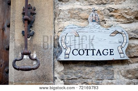Cottage sign with a rustic knocker