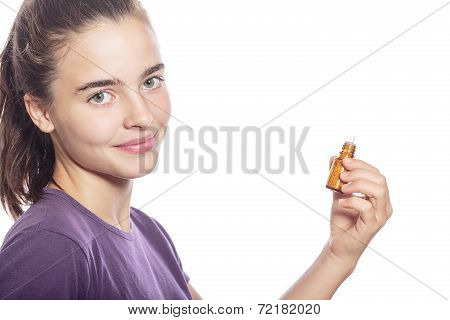 Smiling Woman Is Holding A Bottle Of Homeopathic Medicine, Isolated On White