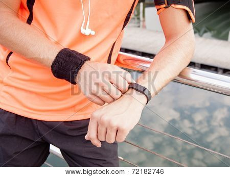 Close up view of guy using fitness device