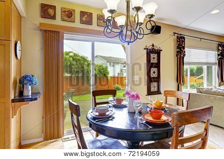Dining Area With Exit To Backyard Patio