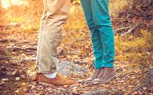 Couple Man and Woman Feet in Love Romantic Outdoor with Autumn season nature on background Fashion trendy style poster