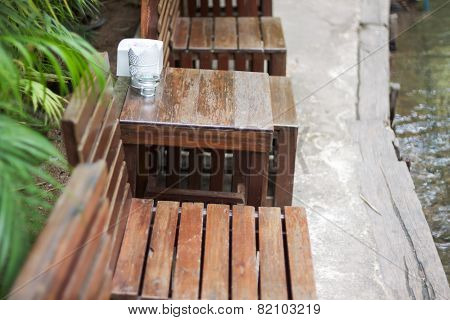Wooden Table Decorated In Restaurant