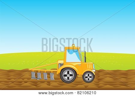 Tractor plows land in field