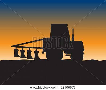 Silhouette of the tractor in field
