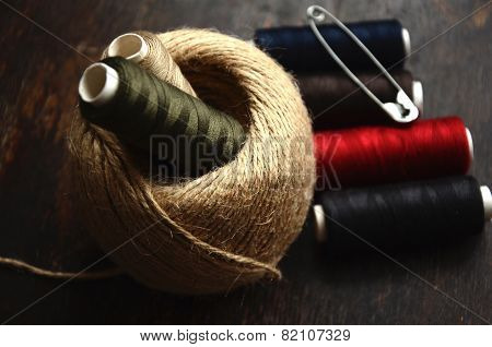 Thread, twine and Safety pin