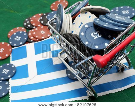 Shopping Cart Full Of Casino Chips Over The Flag Of Greece