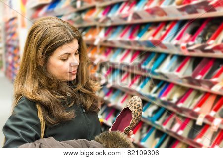 Middle Age Woman Buying Shoes In A Store