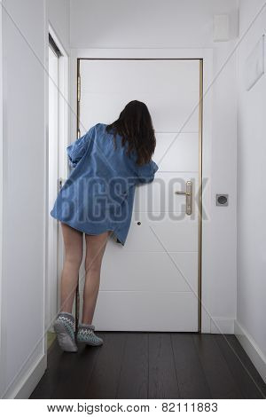 Blue Jeans Shirt Woman Looking At Peephole