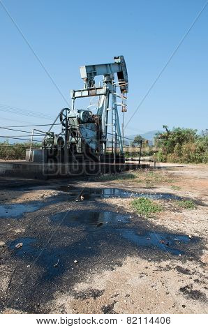 pump jack with crude oil contaminatate to environment poster