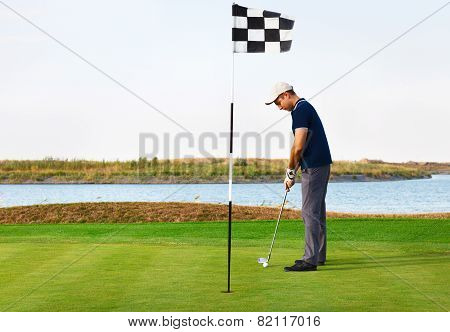 Athletic Young Man Playing Golf