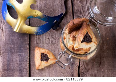 Hamantaschen cookies for Purim festival with carnival mask