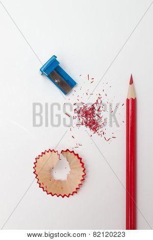 Sharpened pencil, shavings and sharpener. Top view. poster