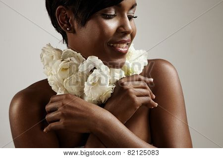 Woman With A Flower Neckless. Perfume Concept