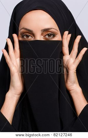 Beautiful Muslim woman looking at camera