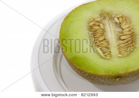 Half Of Melon In Plastic Dish
