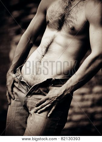 Naked sexual brawny male torso. The man in jeans with a naked torso. poster