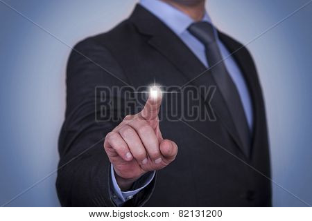 Businessman pressing button on touch screen