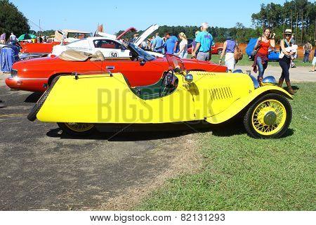 A three wheeled antique car