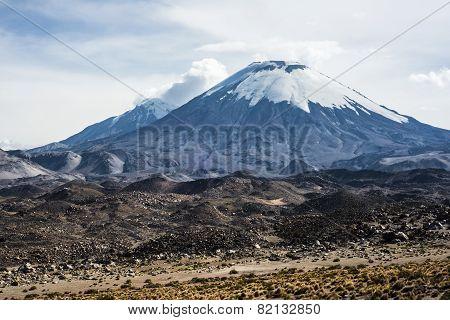 Snow capped Parinacota Volcano, national park Lauca, Chile poster