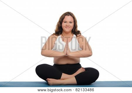 Smiling Woman With Overweight Is Meditating