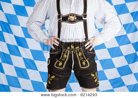 Bavarian man with black Oktoberfest leather pants (Lederhose).