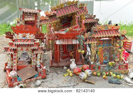 Chinese Shrine That Was Left By The Side Of The Canal .