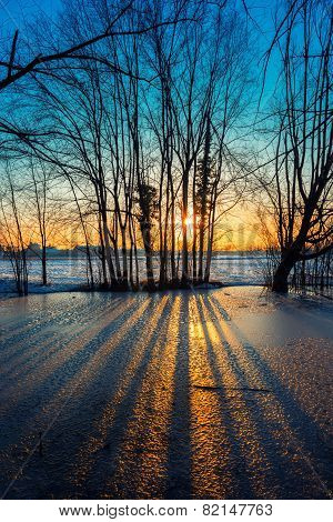 Sunset On Frozen Pond