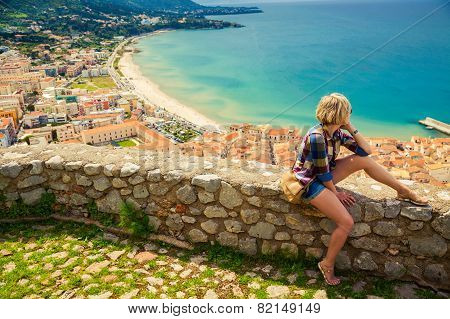 Young Woman Looking To The Cefalu, Sicily