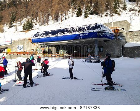 Chairlift cable car and ski slopes in the mountains of Courmayeur winter resort, Italian Alps