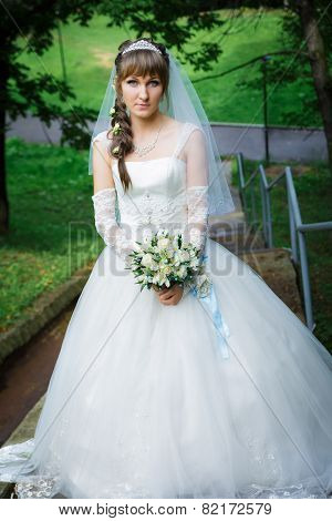 Bride standing on a staircase