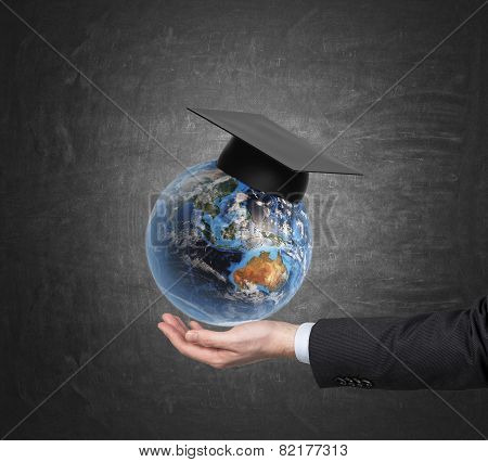 Student Holding Earth