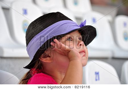 Little girl watching performance at the dolphinarium