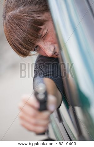 Woman Shooting From A Car