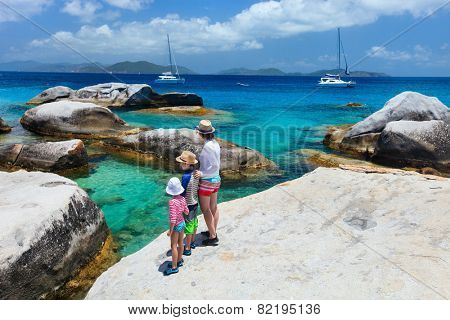 Family of mother and kids enjoying view of beautiful scenery of The Baths beach area major tourist attraction at Virgin Gorda, British Virgin Islands, Caribbean