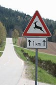 traffic signs in front of intact forest landscapes. poster