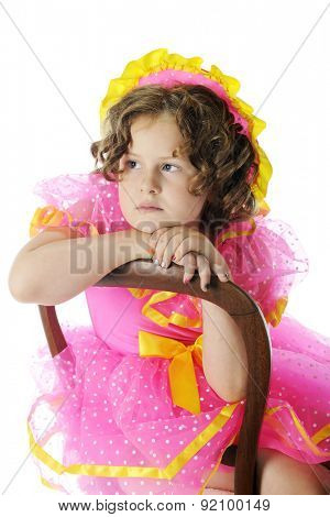 A young elementary girl sitting sadly because she didn't pass the audition as Shirley Temple.  On a white background.