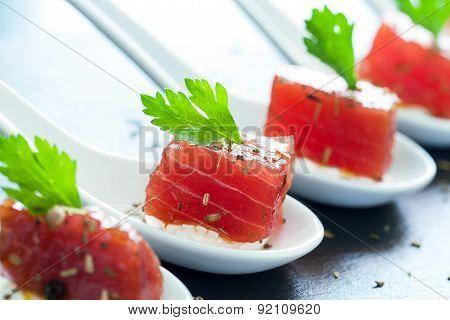 Appetizing Tuna Morsel On Ceramic Spoons.