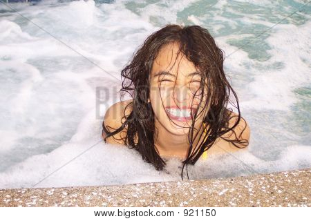 smiling happy pretty girl in spa with foamy bubbly water. poster