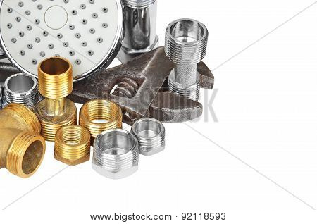 Plumbing fitting, showerhead and wrench