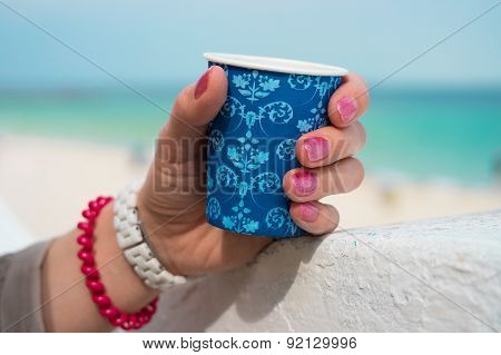 Blue Cup Of Coffee In A Female Hand