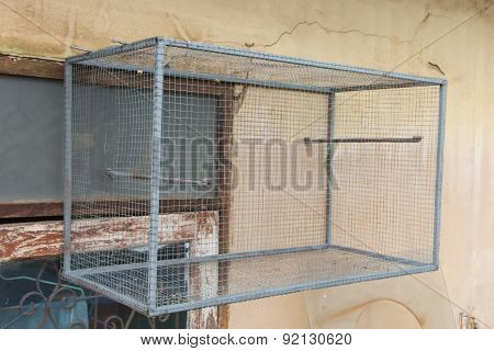 Empty Bird Cage On The Wall