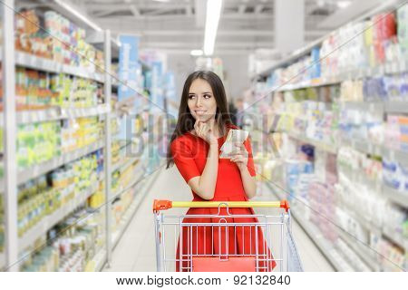 Woman whit Shopping List at The Supermarket