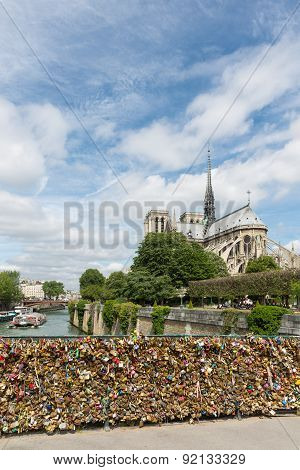 Love Padlocks At Bridge Over River Seine In Paris, France