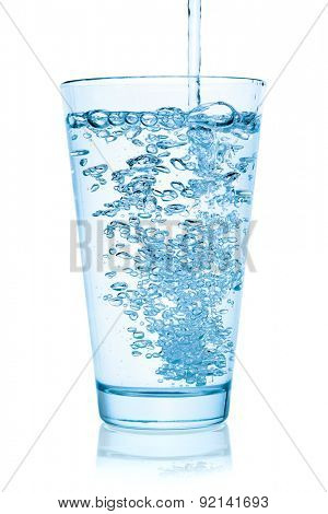 Water pouring into a glass, isolated on the white background, clipping path included.