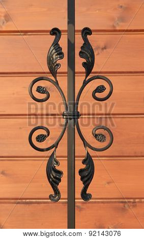 Wrought-iron Fence Elements Of Railing On Wooden Background
