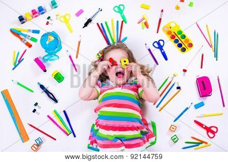 Littel Girl With School Supplies