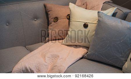 Pillows on a grey modern corner sofa