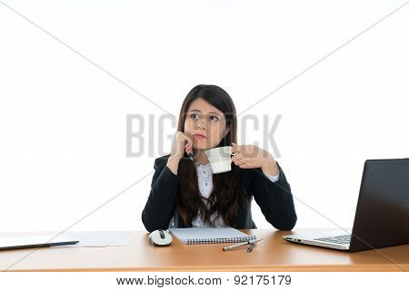 Businesswoman Sitting At Office Desk