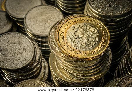 Stacked Mexican Peso Coins