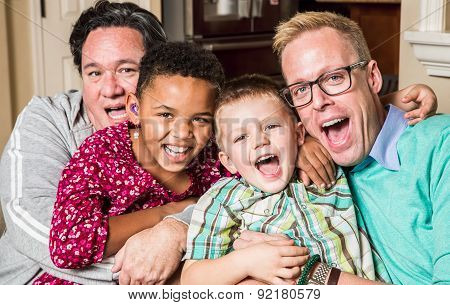 Gay parents pose with their childen in the living room poster
